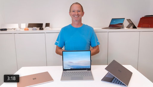 A person displays a variety of Surface devices.