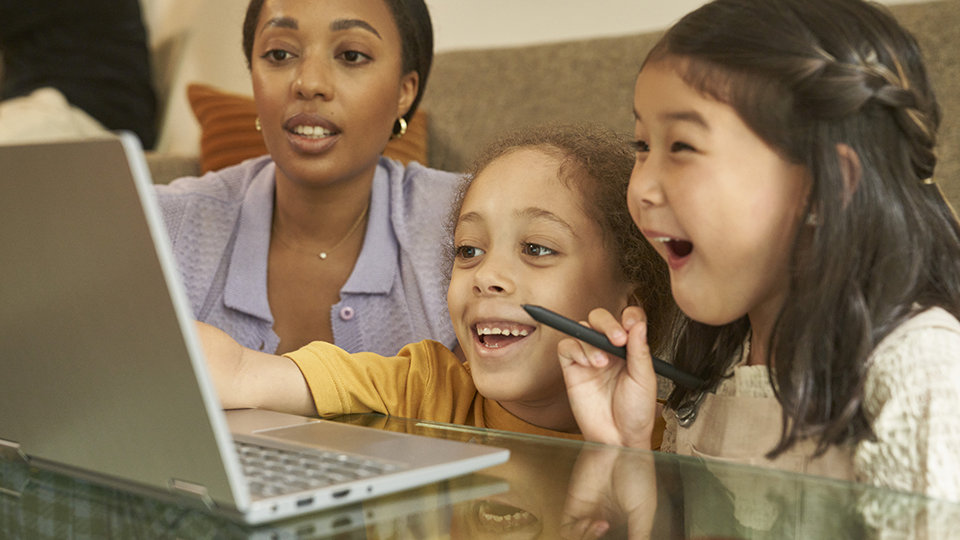 A tablet and smartphone display the Microsoft Family Safety app.