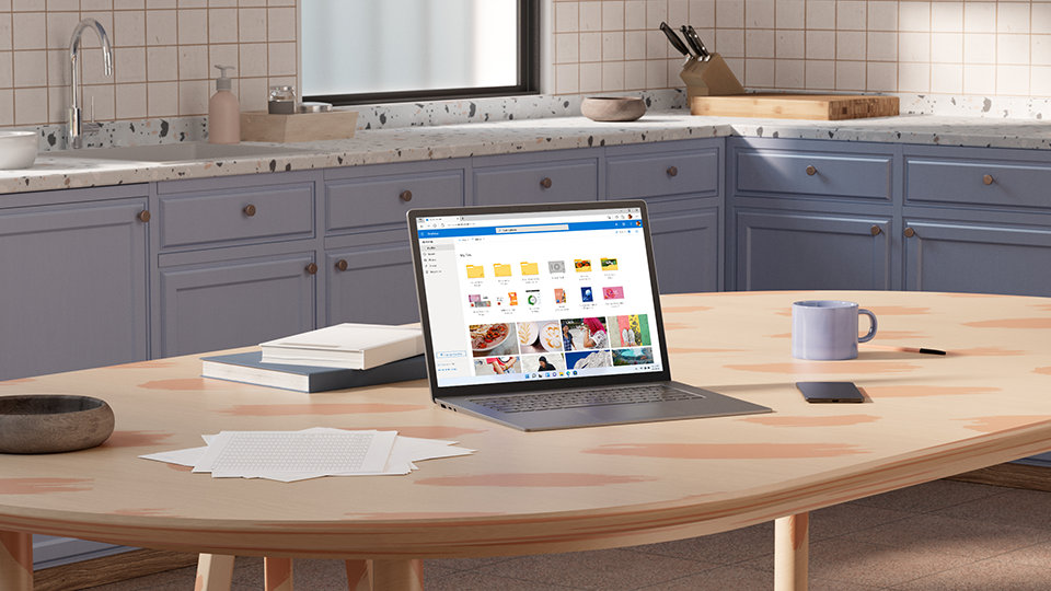 A tablet displays OneDrive, where you can back up photos and files.