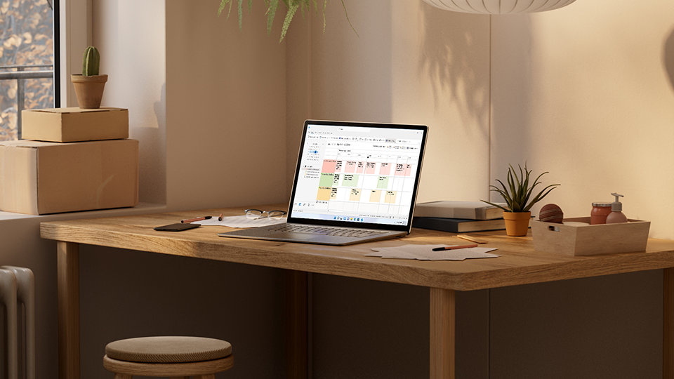 A tablet and phone display Outlook, where you can manage calendars and emails.