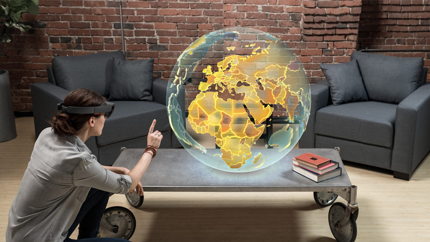 Woman using HoloLens to interact with the globe