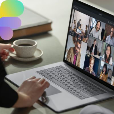 A laptop displaying a Teams video call with many participants.