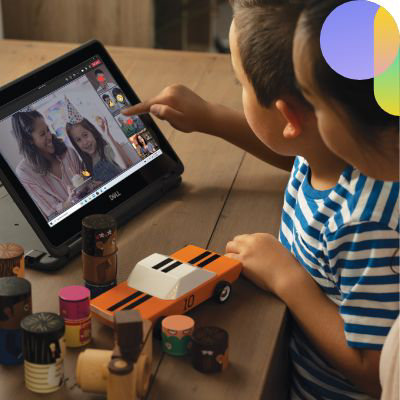 Two children using a tablet to join a birthday party on Teams.