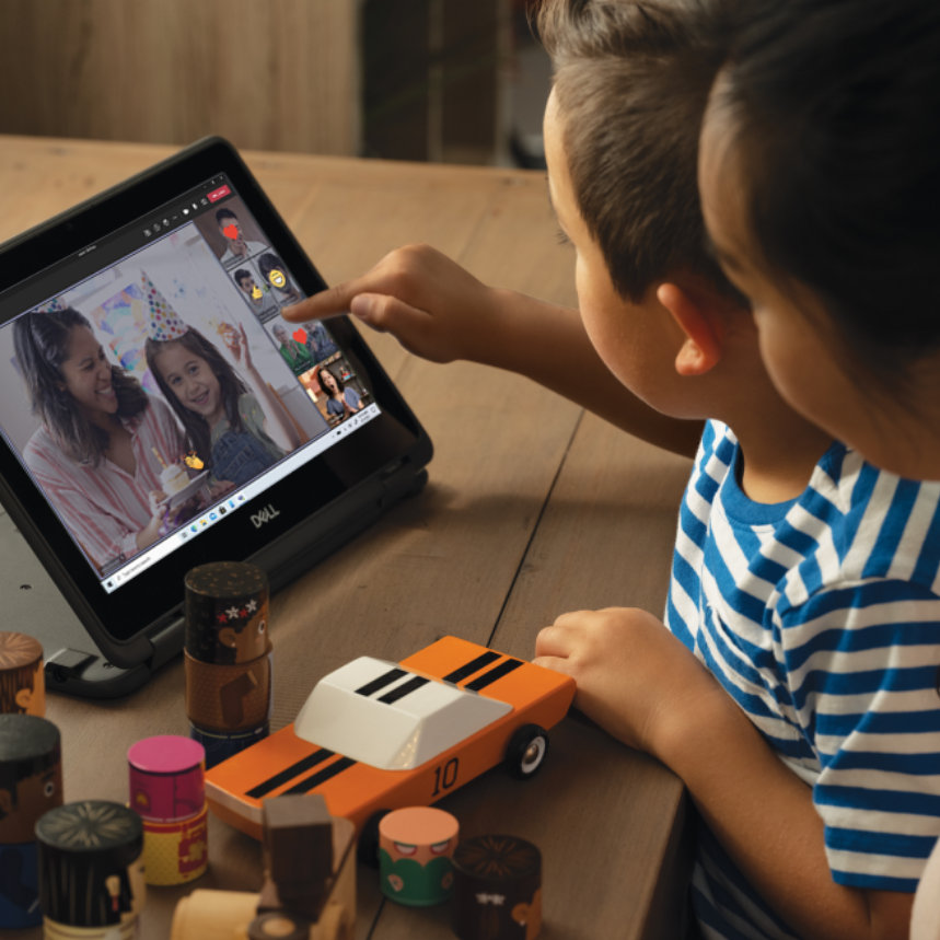 A mother and child using a tablet to participate in a video call with other children and parents.
