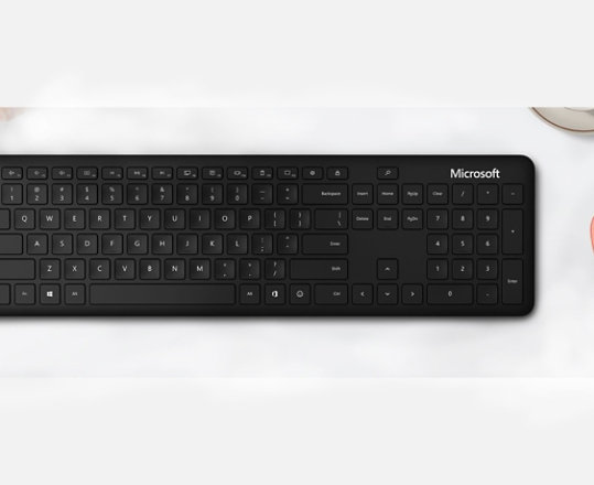 Microsoft Bluetooth Keyboard and mouse on a desk.