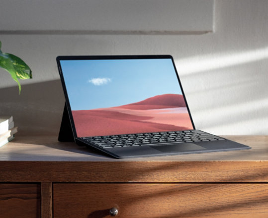 A Surface Pro device sits upon a dresser.