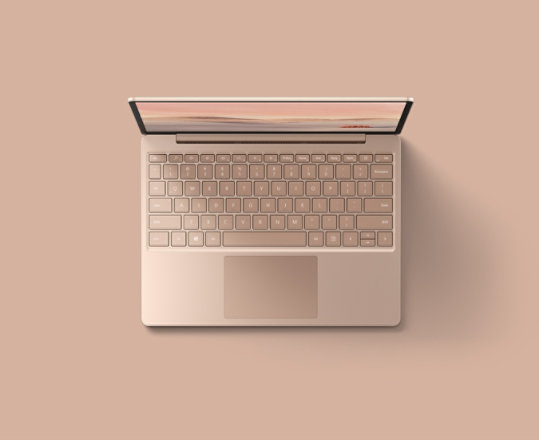 An overhead view of the Sandstone Surface Laptop Go for Business.