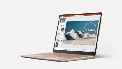Surface Laptop Go in Sandstone with PowerPoint onscreen.