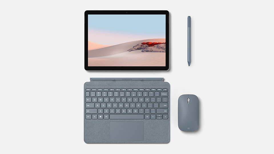 A Surface Go device with a type cover, touch pen and mouse.