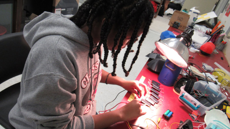 A young student works on a project.