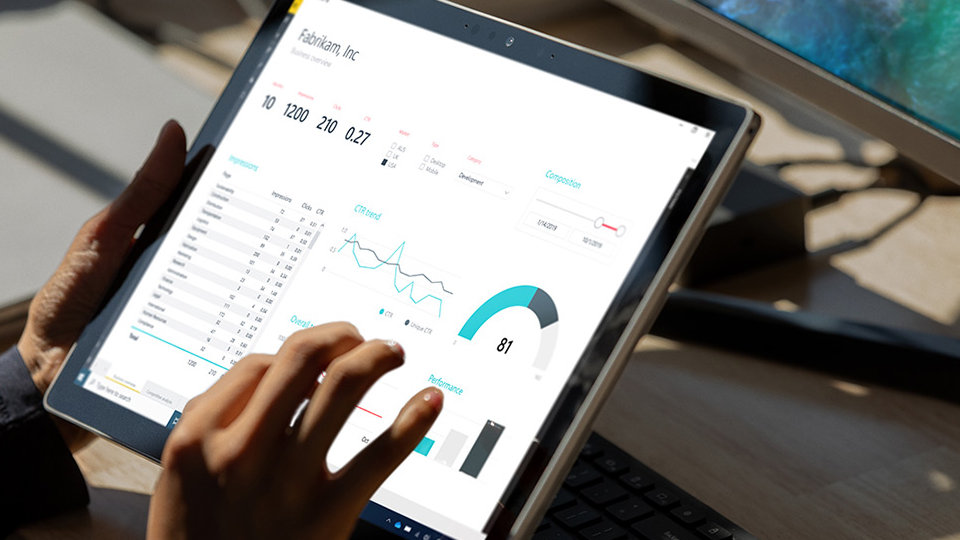 A person uses Microsoft 365 apps on Surface Book 3.