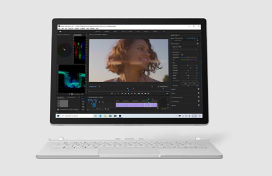 Surface Book 3 with Premiere Pro video editor on screen.