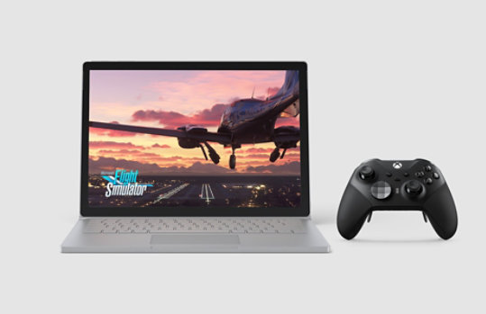 Surface Book 3 with Flight Simulator on screen, next to an Xbox controller.