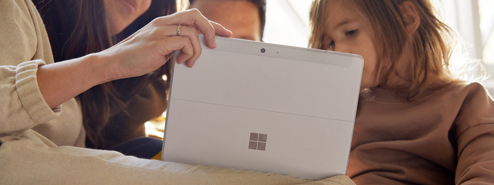 A family using Surface Go 2.