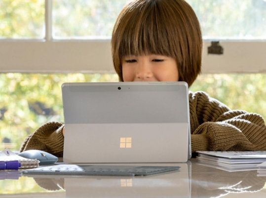 A child using Surface Go 2.