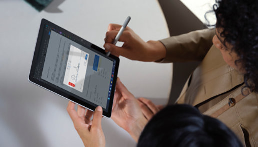 Surface Go 3 for Business showing screen and keyboard.