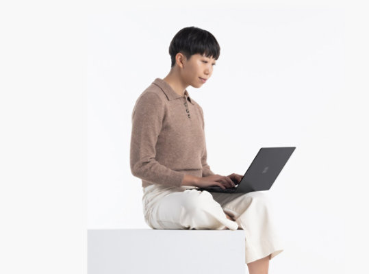 A person uses Surface Laptop 4 in Matte Black.