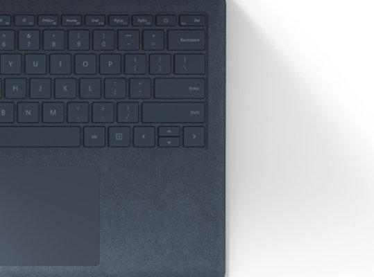 Warm Alcantara keyboard in Ice Blue.