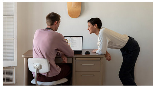 Two people look over data on a Surface Laptop 3.