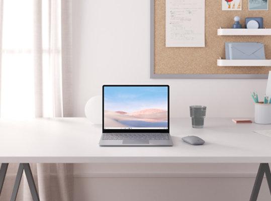 Platinum Surface Laptop Go on a desk.