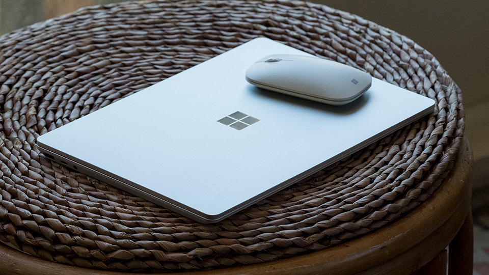 Surface Mobile Mouse, Surface device and Surface Pen on a table.