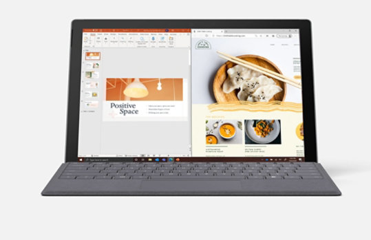 Surface Pro 7 with PowerPoint and a web browser open on screen.