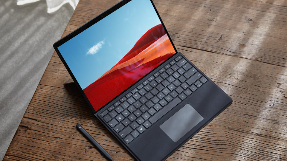 Surface Pro X in laptop mode with keyboard attached.