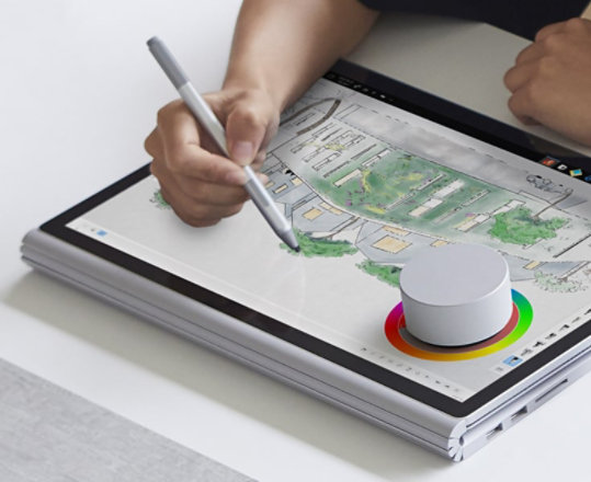 An artist using a Surface Dial to adjust colors.
