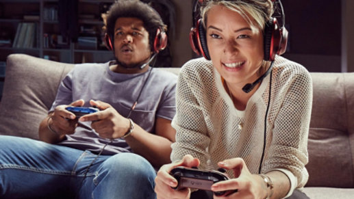 Two people play an Xbox game together.