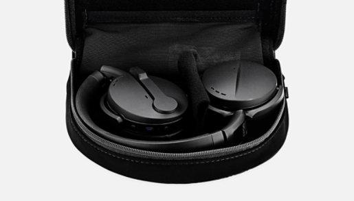Sennheiser Adapt 560 headset in black folded up in their case.