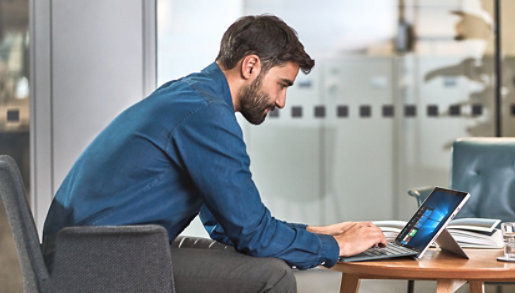A person working on a Surface device in an office.