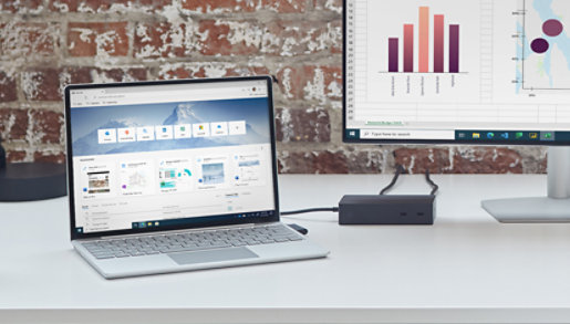 Surface Laptop Go plugged in to a Surface dock and an external monitor