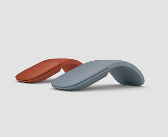 Surface Arc Mouse in Poppy Red and Ice Blue.