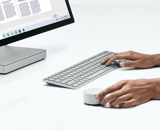 Surface keyboard, Surface Dial, and monitor.