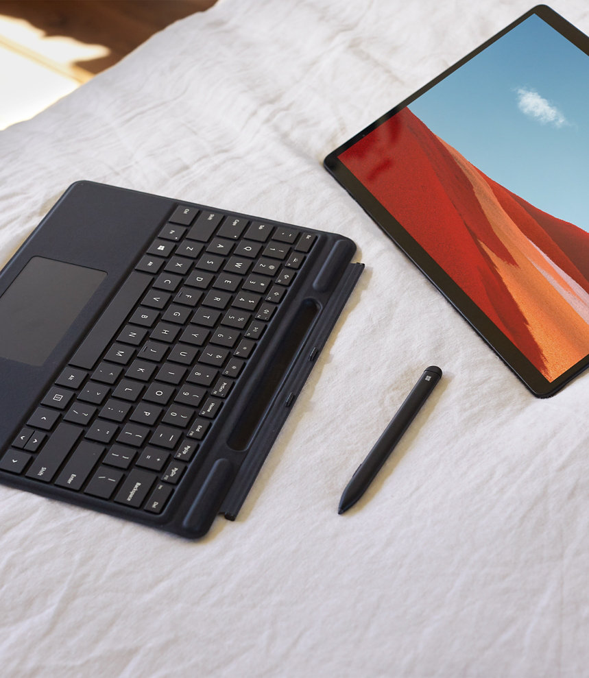 Surface Pro X with pen and keyboard.