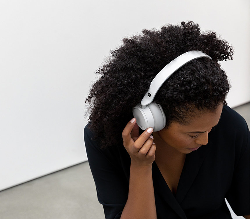 A person listens to music with Surface Headphones.