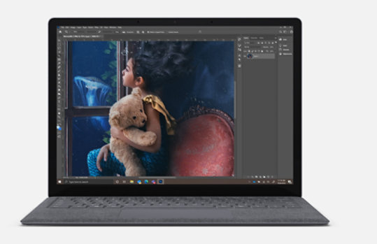 Surface Laptop 3 with photo editing software on screen.